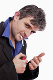 Attractive man lighting a cigarette Stock Photos
