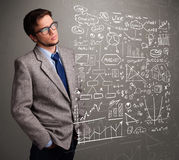 Attractive man looking at stock market graphs and symbols Stock Images