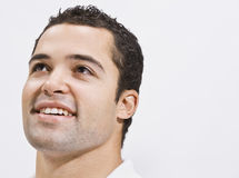 Attractive Man Looking Up and Smiling Royalty Free Stock Images