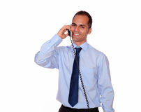 Attractive man looking at you speaking on phone Royalty Free Stock Photos