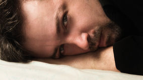 Attractive man lying on a bad royalty free stock images