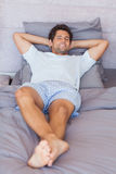 Attractive man lying in bed Royalty Free Stock Photo