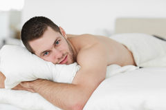 Attractive man lying on his belly Royalty Free Stock Image