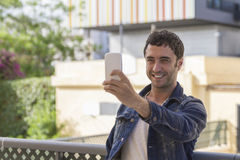 Attractive man making a selfy Stock Images