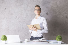 Attractive man with notepad Stock Images