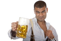 Attractive man with Oktoberfest beer stein Royalty Free Stock Photos