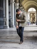 Attractive man outdoor wearing business suit jacket. Attractive man outdoor wearing elegant jacket, in European city, Turin in Italy Royalty Free Stock Photo