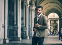 Attractive man outdoor wearing business suit jacket. Attractive man outdoor wearing elegant jacket, in European city, Turin in Italy Stock Images