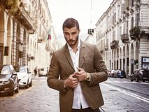 Attractive man outdoor wearing business suit jacket. Attractive man outdoor wearing elegant jacket, in European city, Turin in Italy Stock Photography