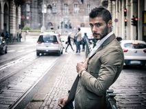 Attractive man outdoor wearing business suit jacket. Attractive man outdoor wearing elegant jacket, in European city, Turin in Italy Royalty Free Stock Photography
