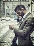 Attractive man outdoor wearing business suit jacket. Attractive man outdoor wearing elegant jacket, in European city, Turin in Italy Royalty Free Stock Image