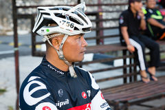 Attractive man in the outfit cyclist at the stadium Stock Image
