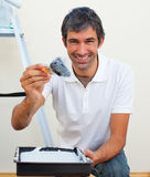 Attractive man painting a wall. In his new house Stock Images