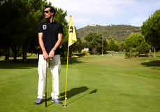 attractive man playing golf on a warm summer day Stock Photo
