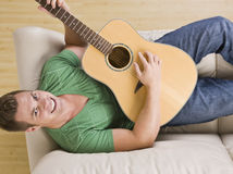 Attractive Man Playing Guitar Royalty Free Stock Photo