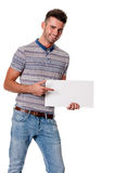 Attractive man pointing to blank card Stock Photo