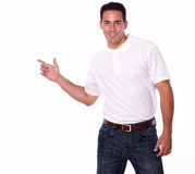 Attractive man pointing to his right Royalty Free Stock Photography