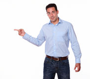Attractive man pointing to his right royalty free stock photo