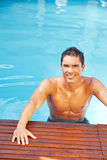 Attractive man in pool water Stock Image