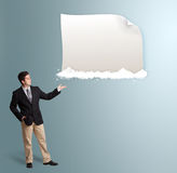 Attractive man presenting modern copy space on clouds Stock Image