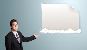 Attractive man presenting modern copy space on clouds Royalty Free Stock Photography