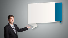 Attractive man presenting modern origami copy space Stock Photos