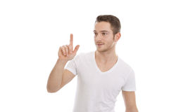 Attractive man presses button - t-shirt Stock Photo