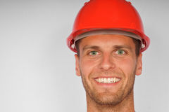 Attractive man in a protective helmet Royalty Free Stock Images