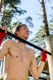Attractive man pull-ups on a bar Stock Photography