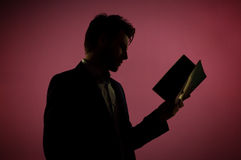 Attractive man reading the book Stock Image