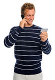 Attractive man reading out credit card number Royalty Free Stock Image
