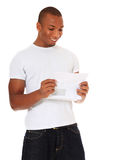 Attractive man reads a letter Stock Image