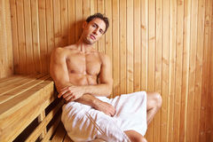 Attractive man relaxing in sauna Stock Photos