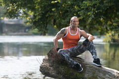 Attractive Man Resting Outdoors In Nature Afther Exercise Royalty Free Stock Photos
