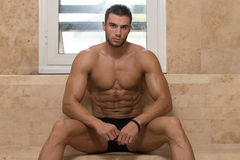 Attractive Man Resting Relaxed In Sauna Royalty Free Stock Photography