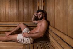 Attractive Man Resting Relaxed In Sauna Stock Photo