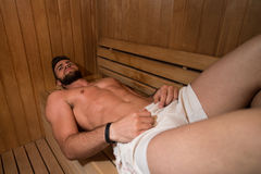 Attractive Man Resting Relaxed In Sauna Stock Images
