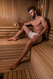 Attractive Man Resting Relaxed In Sauna Stock Image