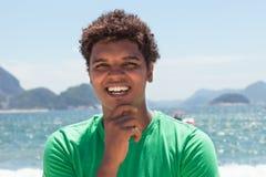 Attractive man from Rio de Janeiro at Copacabana beach Stock Image