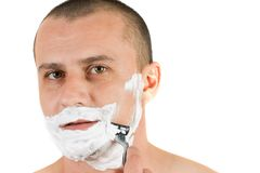 Attractive man shaving Royalty Free Stock Images