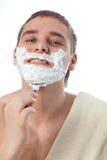 Attractive man shaving his face Royalty Free Stock Photography