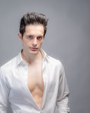 Attractive Man With Shirt Unbuttoned Stock Image