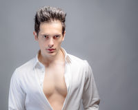 Attractive Man With Shirt Unbuttoned Stock Images