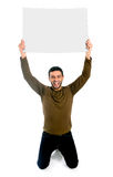 Attractive man showing and pointing blank billboard Royalty Free Stock Photo