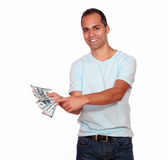 Attractive man showing you cash money Stock Images