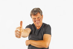 Attractive man shows  thumbs up Stock Photos