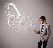 Attractive man singing and listening to music with abstract head Royalty Free Stock Image