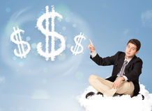 Attractive man sitting on cloud next to cloud dollar signs. Attractive young man sitting on cloud next to cloud dollar signs royalty free stock photo