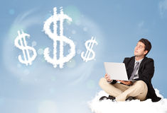 Attractive man sitting on cloud next to cloud dollar signs. Attractive young man sitting on cloud next to cloud dollar signs stock photography