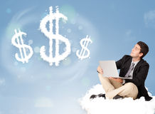 Attractive man sitting on cloud next to cloud dollar signs. Attractive young man sitting on cloud next to cloud dollar signs royalty free stock images